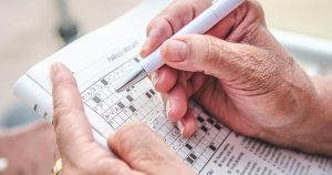Elder person completing a crosswords