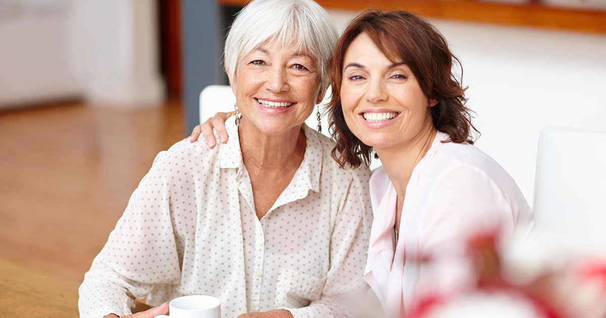 Elderly mother and adult daughter spending time together