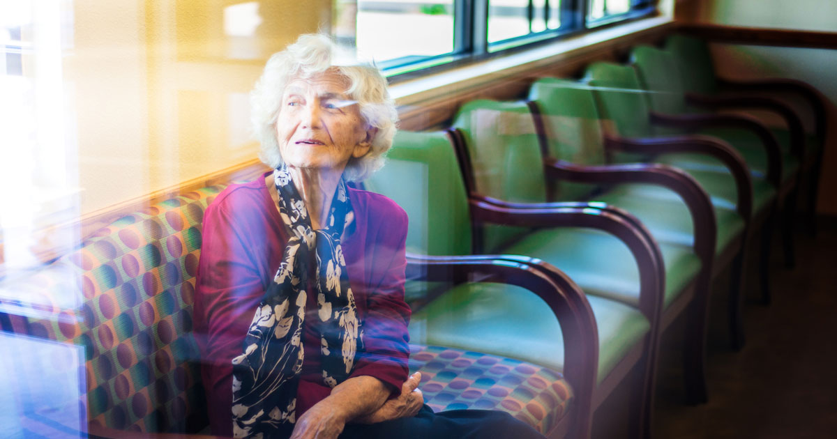 Elderly woman sitting in a waiting room