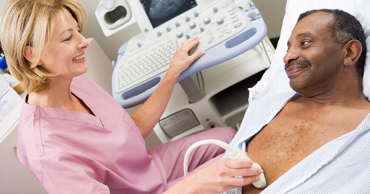 Ultrasound technician examining a patient's heart