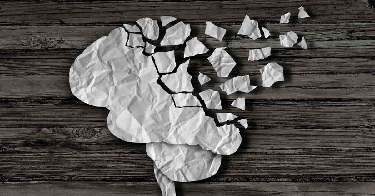 Ripped up paper beside a paper brain