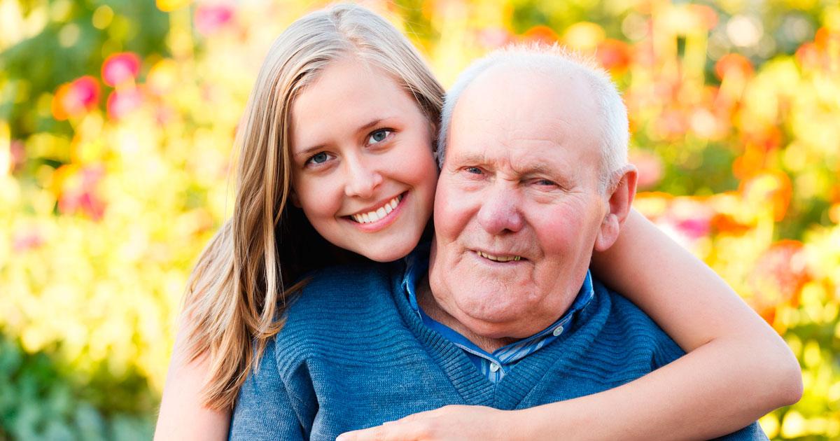 Daughter hugging grandparent
