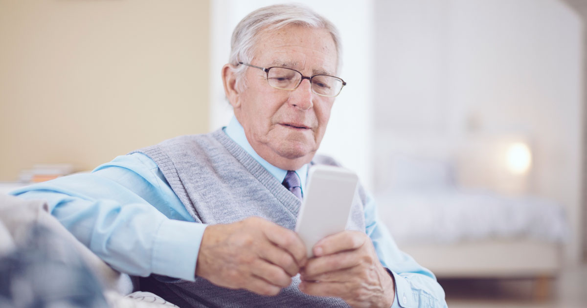 Senior man on his smartphone